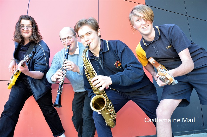 Castlemaine secondary college music students Tom, Jeremy and Finn with music teacher Ben Nieuwkerk (on clarinet) get set for the Castlemaine Jazz Festival. Photo: Eve Lamb