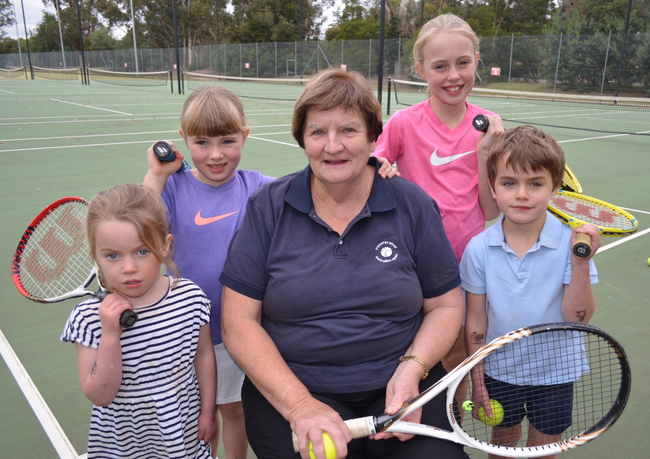 Local tennis coach Jill Atkin is proudly pictured with her grandchildren Winnie, Vivienne, Willow and Sandy.