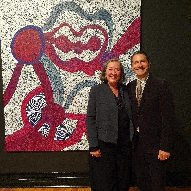 Sotheby's Australia chairman and 2019 Len Fox judge, Geoffrey Smith is pictured with Beverly Knight, director Alcaston Gallery who represented winning artist Betty Kuntiwa Pumani with the 2019 winning work Antara.