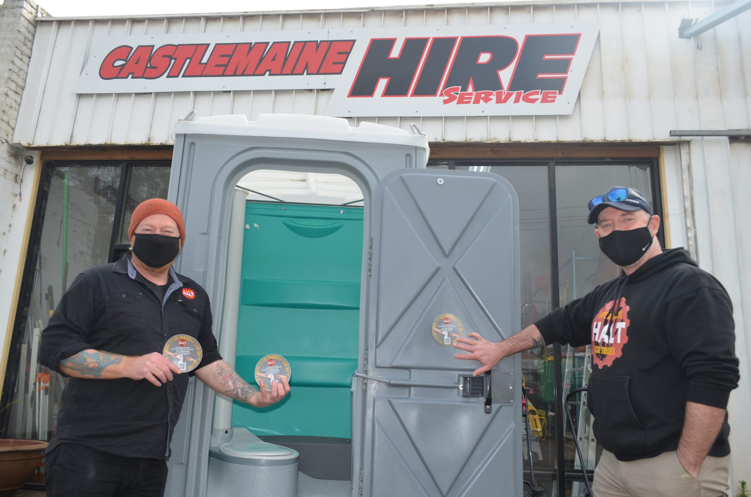 R U Okay? Feeling Sh*t? This new HALT initiative aims to help tradies across the country. HALT founder Jeremy Forbes and HALT North West region project worker Tom Kenneally are pictured with the new stickers at Castlemaine Hire Service earlier this week.